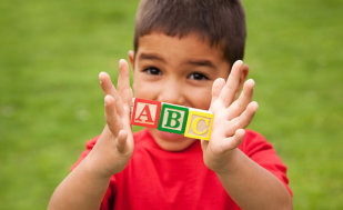 child playing alphabet blocks
